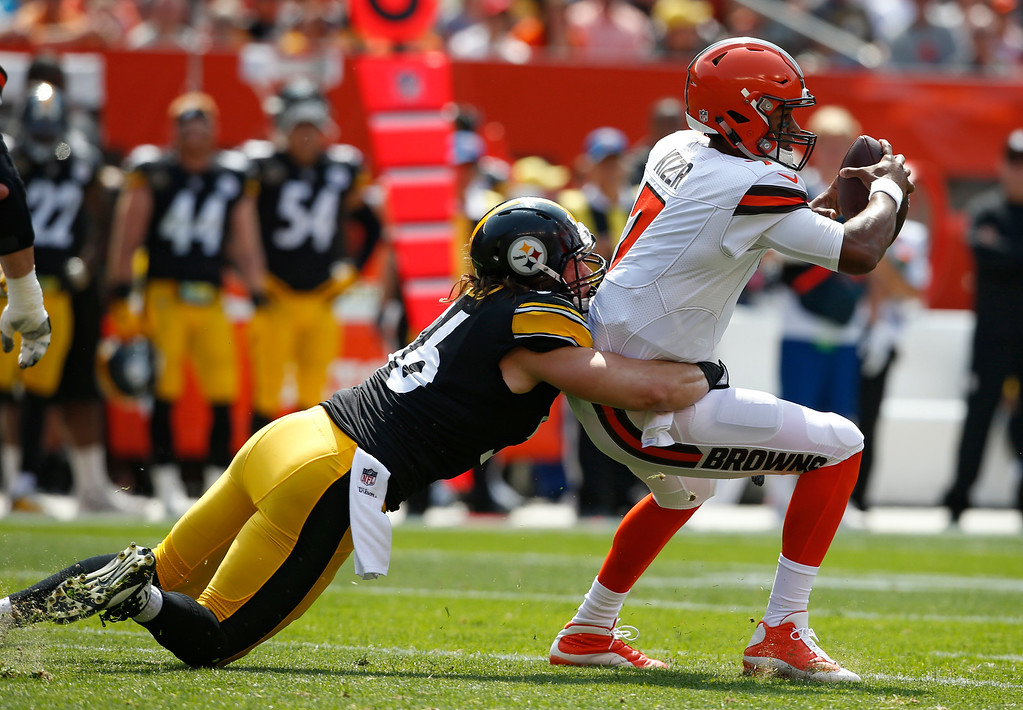 . Cleveland Browns quarterback DeShone Kizer, right, is tackled by Pittsburgh Steelers outside linebacker Anthony Chickillo during the first half of an NFL football game, Sunday, Sept. 10, 2017, in Cleveland. (AP Photo/Ron Schwane)