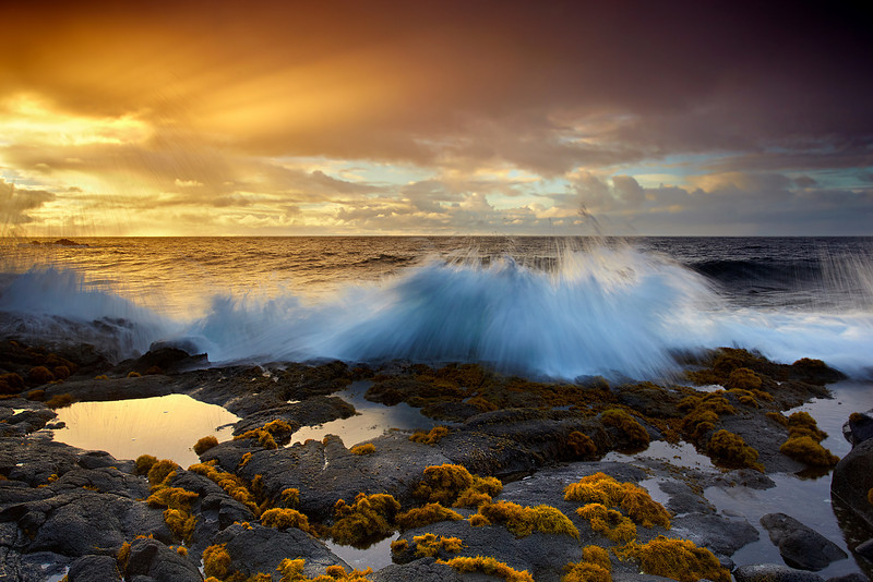 Ahalanui is home to an incredible hot pool with water that is nearly body temperature.  it also has some excellent coastal scenery and large breaking waves.  Sunrise is the best time to see the drama at its best!