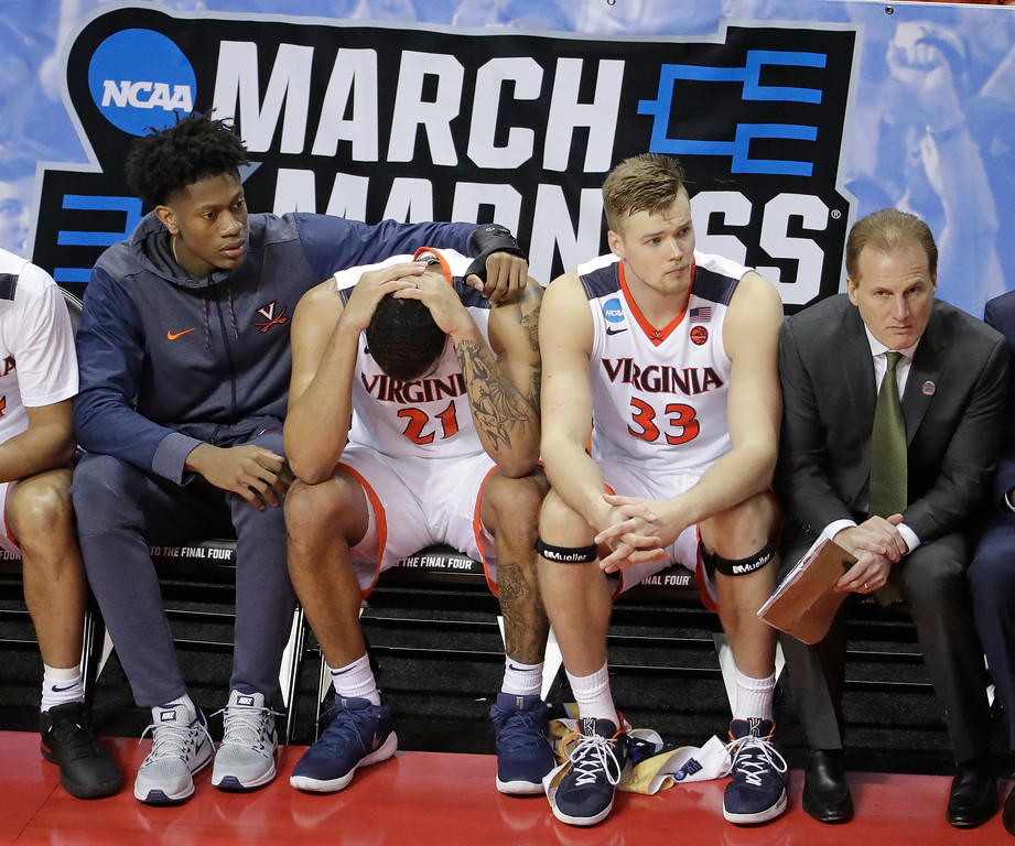 . Virginia\'s Isaiah Wilkins (21) is consoled after fouling out during the second half of a first-round game against UMBC in the NCAA men\'s college basketball tournament in Charlotte, N.C., Friday, March 16, 2018. (AP Photo/Chuck Burton)