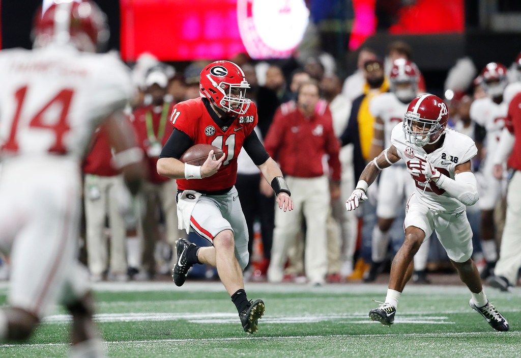 . Georgia quarterback Jake Fromm runs during the first half of the NCAA college football playoff championship game against Alabama Monday, Jan. 8, 2018, in Atlanta. (AP Photo/David Goldman)