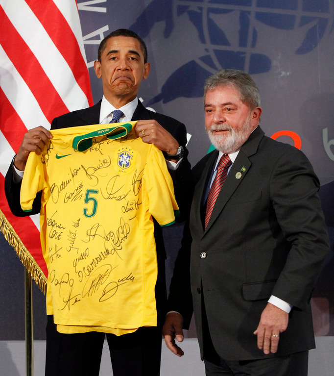 . U.S. President Barack Obama, left, is presented with a soccer shirt by Brazil\'s President Luiz Inacio Lula da Silva, signed by the Brazilian national soccer team, during the G8 Summit in L\'Aquila, Italy, Thursday, July 9, 2009. (AP Photo/Haraz N. Ghanbari)