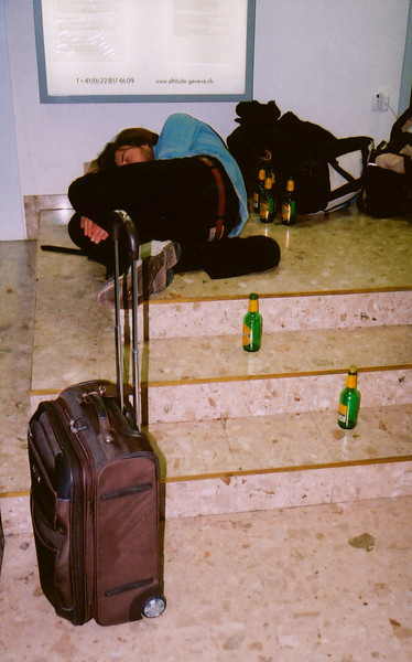Michael passed out directly in front of security headquarters at the Geneva airport after tossing back a 24 pack while waiting for an early morning flight to Marrakesh. Photo by Steve Elkins.