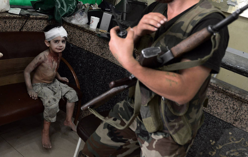 . A Syrian boy who was injured when a shell, released by regime forces, hit his house on August 24, 2012, waits to be treated at a hospital in Syria\'s northern city of Aleppo. Syrian forces blitzed areas in and around the Aleppo , activists said, as Western powers sought to tighten the screws on embattled President Bashar al-Assad.  AFP PHOTO / ARIS  MESSINIS/AFP/Getty Images