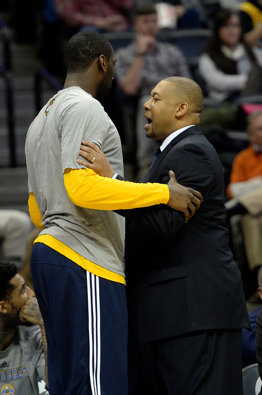 . DENVER, CO - MARCH 03: Melvin Hunt of the Denver Nuggets speaks with J.J. Hickson (7) on the bench during the second half of a 106-95 Nuggets win over the Milwaukee Bucks. The Denver Nuggets hosted the Milwaukee Bucks at the Pepsi Center on Tuesday, March 3, 2015. (Photo by AAron Ontiveroz/The Denver Post)