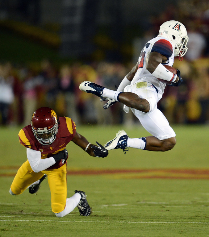. USC\'s  Josh Shaw #6 tackles Arizona\'s Ka\'Deem Carey #25 during their game at the Los Angeles Memorial Coliseum Thursday, October 10, 2013. (Photo by Hans Gutknecht/Los Angeles Daily News)