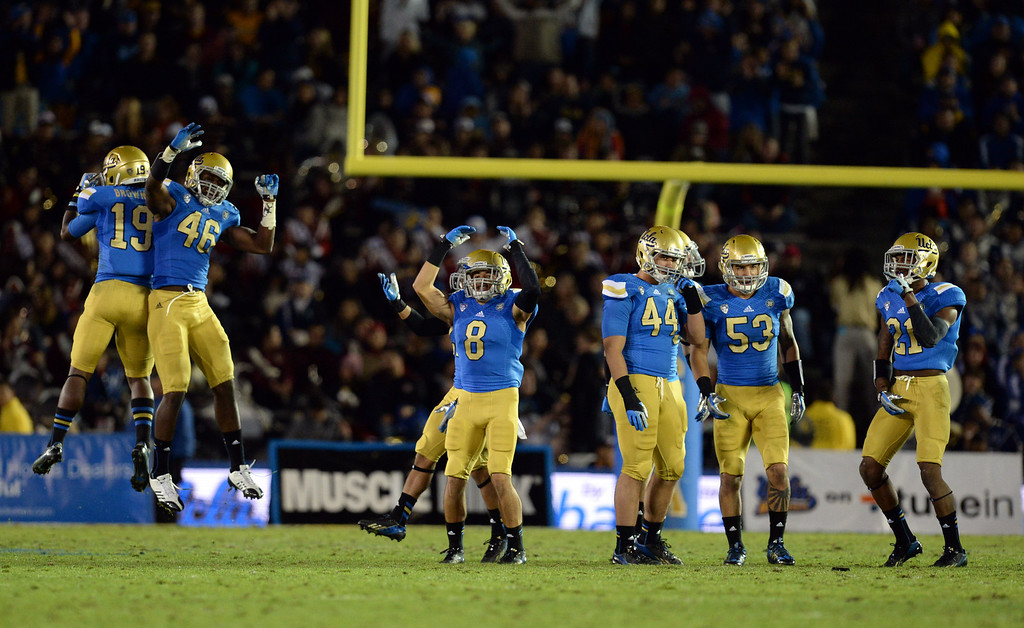 . UCLA players get fired up in the second half during their game against Arizona State  at the Rose Bowl Saturday November 23, 2013. Arizona State beat UCLA 38-33. (Photos by Hans Gutknecht/Los Angeles Daily News)