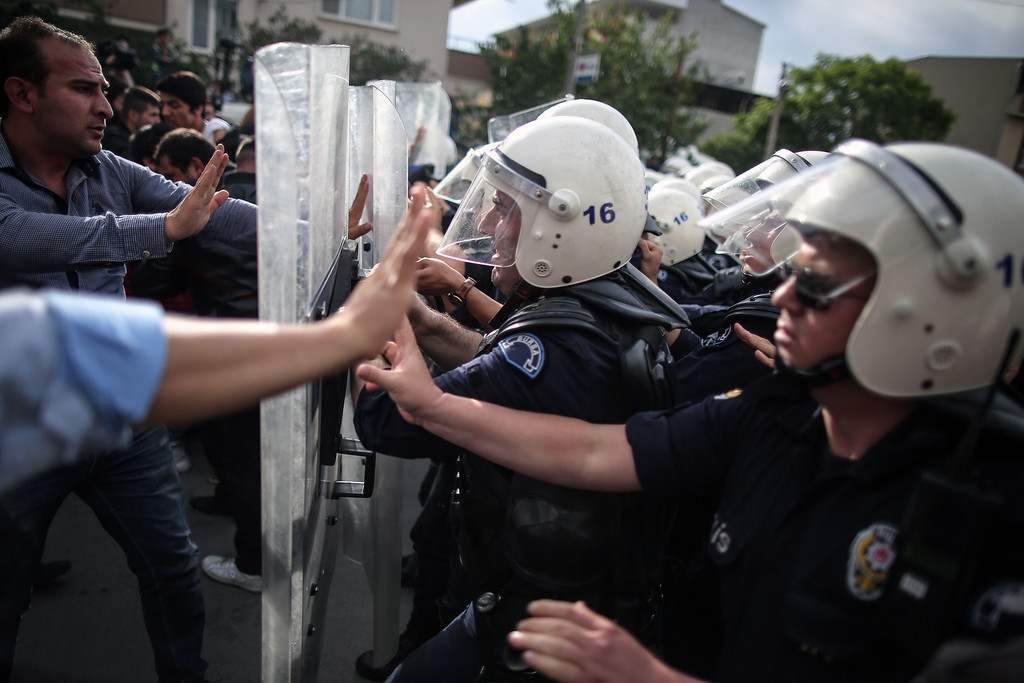 . Riot police try to stop protesters who were attacking the offices of Prime Minister Recep Tayyip Erdogan\'s Justice and Development Party, in Soma, Turkey, during his visit to the coal mine in Soma Wednesday, May 14, 2014.  (AP Photo/Emrah Gurel)