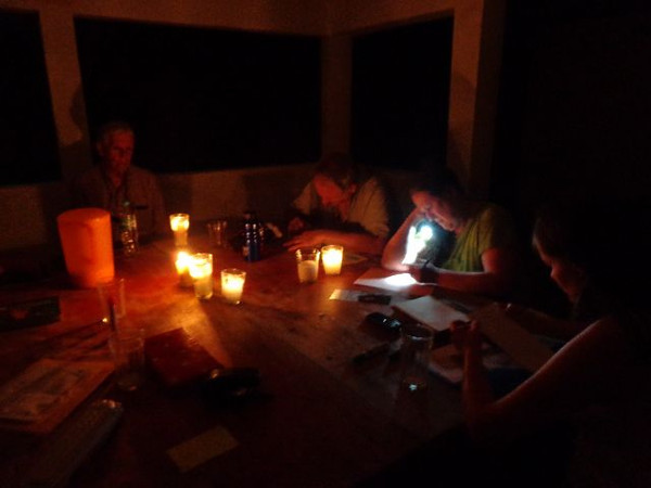 Reflection on action is a consistent part of Amextra's philosophy of transformation. Here, participants in the February 2013 Seeds of Transformation program write some of their thoughts by the light of candles and a flashlight.