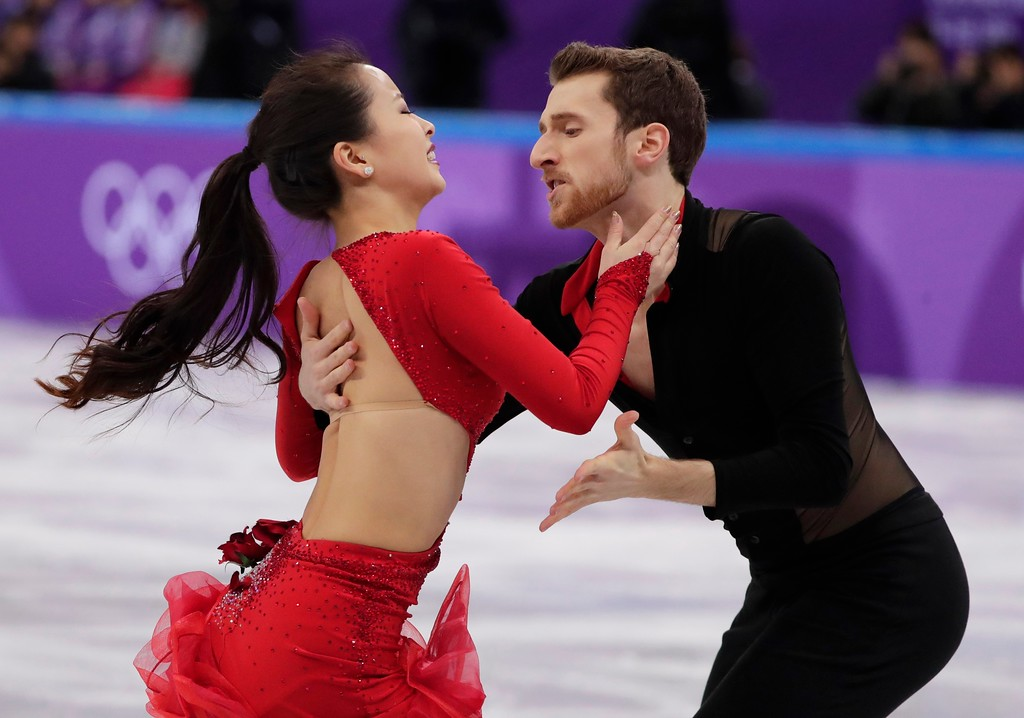 . FILE - In this Sunday Feb. 11, 2018 file photo, Yura Min and Alexander Gamelin of South Korea perform during the ice dance short dance team event in the Gangneung Ice Arena at the 2018 Winter Olympics in Gangneung, South Korea. Some three dozen skaters in the Pyeongchang Games are performing for nations in which they were not born. (AP Photo/Julie Jacobson, File)