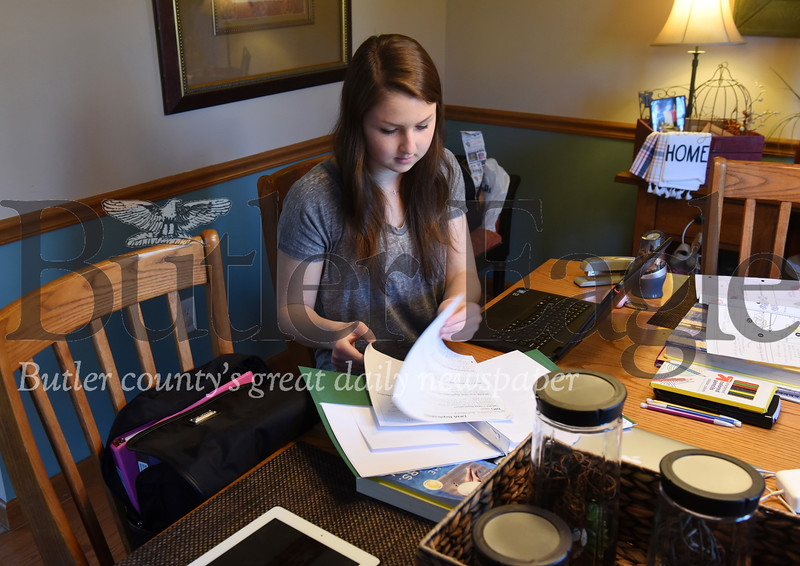 Harold Aughton/Butler Eagle: Maddie Bunofsky, 18, a senior at Seneca Valley High School, has turned her parent's dining room into a makeshift study room.
