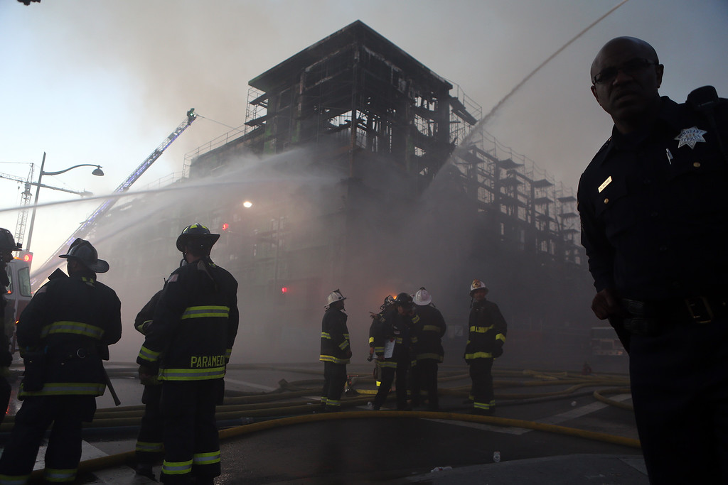 . San Francisco firefighters battle a 6-alarm fire on an apartment complex under construction at Fourth Street near China Basin in San Francisco, Calif., on Tuesday, March 11, 2014. (Ray Chavez/Bay Area New Group)