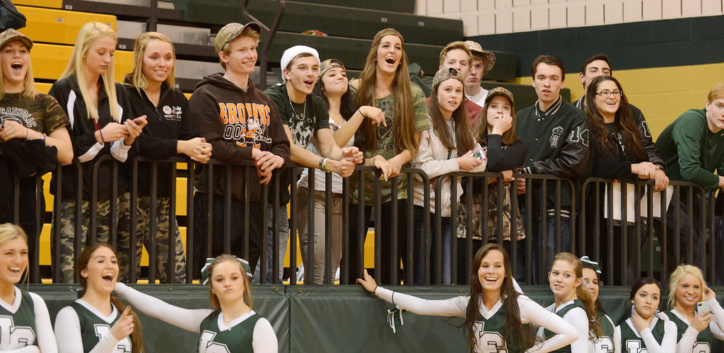 . Maribeth Joeright/MJoeright@News-Herald.com Lake Catholic students watch and celebrate as the boys basketball team receives the Division II district championship trophy after defeating Chagrin Falls by a score of 68-59, March 8, 2014.