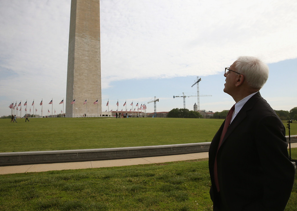 . Philanthropist David David Rubenstein looks at the Washington Monument May 12, 2014 on the ground of the monument in Washington, DC. Mr. Rubenstein matched the federal funding of $7.5 million to repair the monument that was damaged by a 5.8-magnitude earthquake that struck the Washington, DC, area on August 23, 2011  (Photo by Mark Wilson/Getty Images)