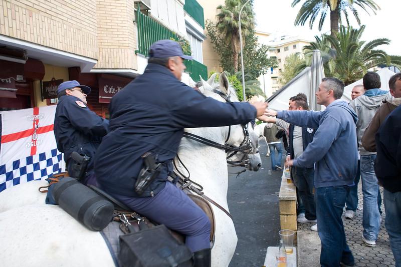 Horseback policemen in action against Tottenham fans, Seville, Spain