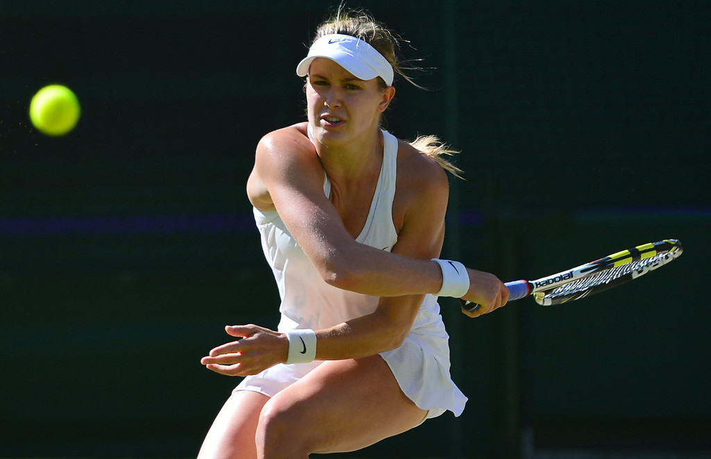 . Canada\'s Eugenie Bouchard returns to Romania\'s Simona Halep during their women\'s singles semi-final match on day ten of the 2014 Wimbledon Championships at The All England Tennis Club in Wimbledon, southwest London, on July 3, 2014. Bouchard won 7-6, 6-2.   CARL COURT/AFP/Getty Images