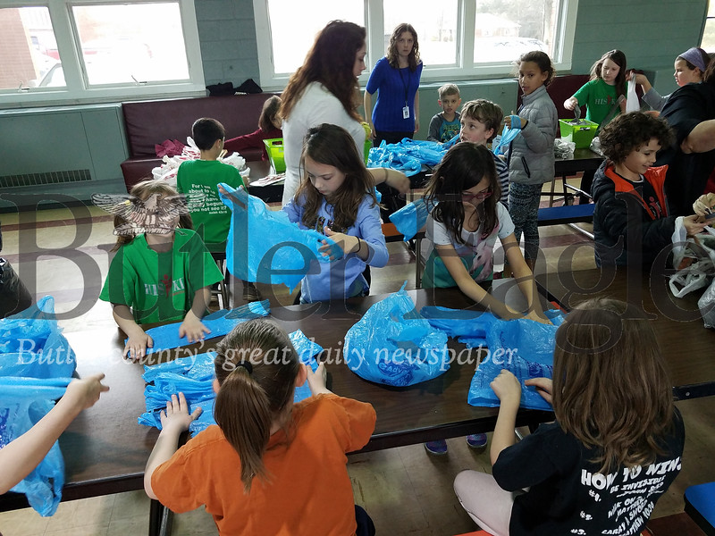 Christine Kunkel shows off a mat in progress and HIS Kids Christian School students covert plastic bags to PLARN PHOTOS BY ERIC FREEHLING
