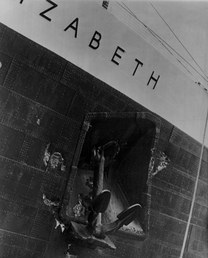 . Liner Queen Elizabeth shows collision scars on Jul. 30, 1959. Dented plates are on starboard side of prow.  (AP Wirephoto)