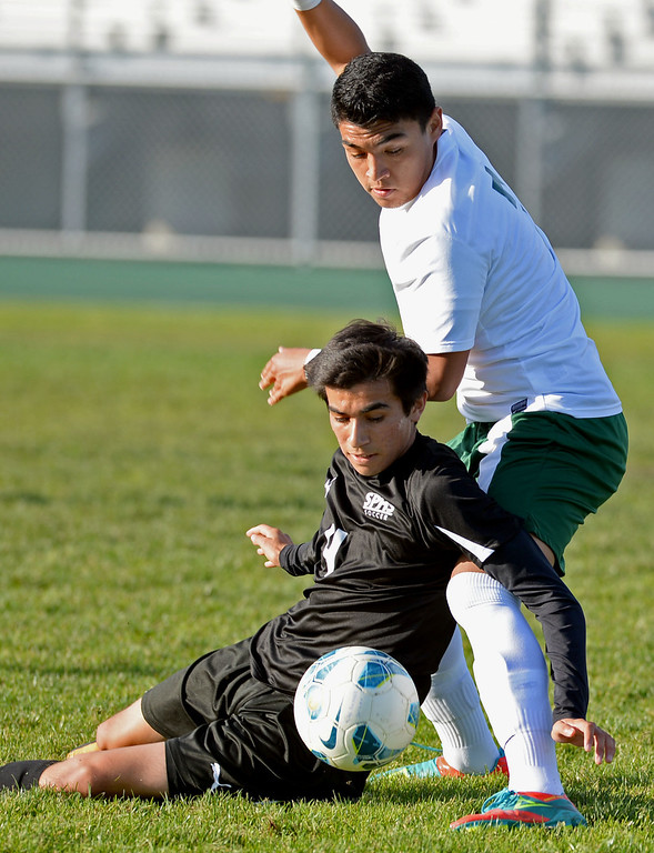 . Narbonne\'s Juan Lemus (7) and San Pedro\'s Hector Hinojos (4) get tangled as they battle each other in a Marine League boys soccer game Wednesday, February 12, 2014, Harbor City, CA.  Narbonne won 2-0 and seals the league title. Photo by Steve McCrank/Daily Breeze