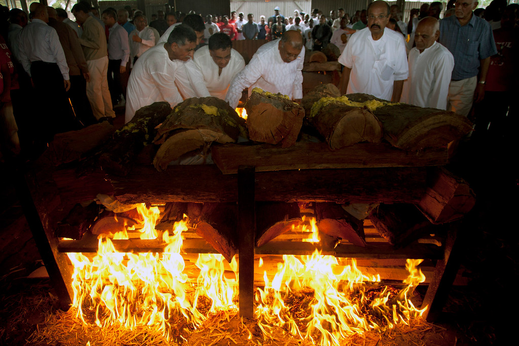 . Family members light the funeral pyre of Mitul Amritlal Shah, of Bidco Group of Kenya,who was shot dead in the attack on the Westgate Mall,  at the Hindu Crematorium in Nairobi, Kenya Thursday, Sept. 26, 2013. (AP Photo/Sayyid Azim)