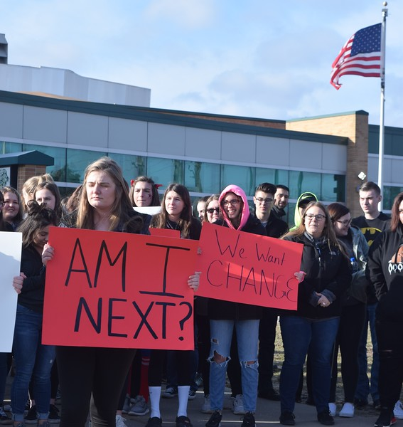While some Allen Park High School students gathered on the football field, others protested in front of the school, holding signs with the names of the 17 people who died in the Feb. 14 shooting in Parkland, Florida. The students also called for an end to school shootings. Jim Kasuba – The News-Herald