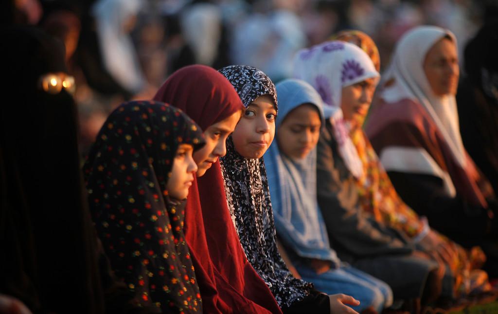. Palestinian girls pray on the first day of Eid al-Adha in Al-Yarmouk stadium in Gaza City, Tuesday, Oct. 15, 2013. (AP Photo/Hatem Moussa)