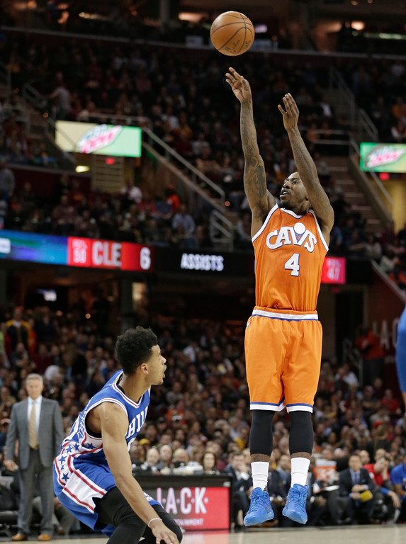 . Cleveland Cavaliers\' Iman Shumpert (4) shoots against the Philadelphia 76ers in the first half of an NBA basketball game, Friday, March 31, 2017, in Cleveland. (AP Photo/Tony Dejak)