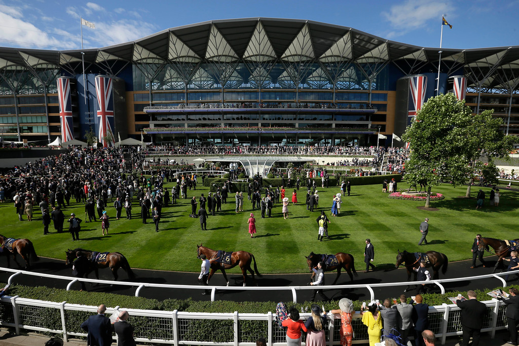 . Racegoers watch horses in the parade ring on the second day of the Royal Ascot horse race meeting in Ascot, England, Wednesday, June 20, 2018. (AP Photo/Tim Ireland)