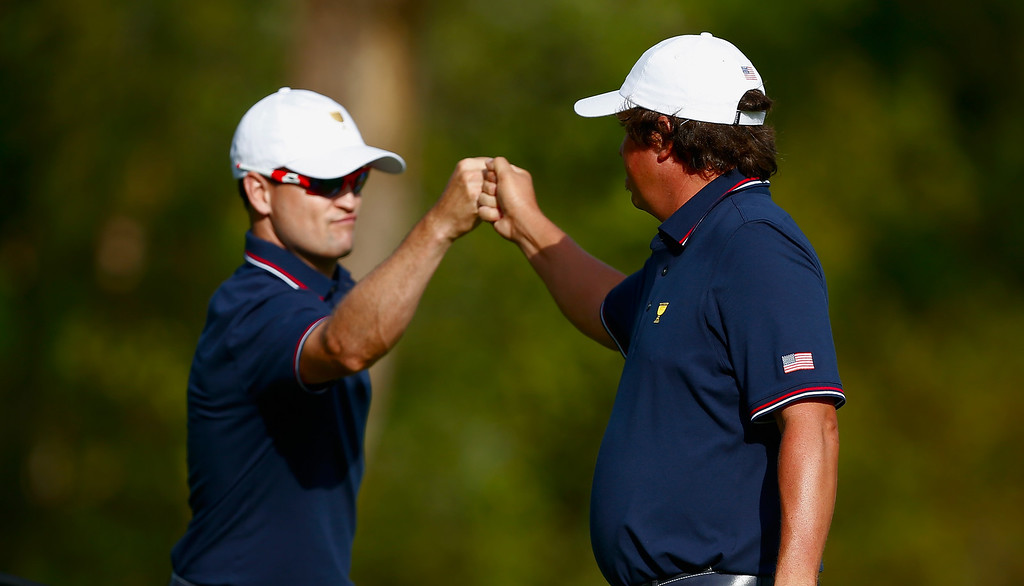 . DUBLIN, OH - OCTOBER 03:  Zach Johnson (L) and Jason Dufner of the U.S. Team celebrate a birdie on the ninth hole during the Day One Four-Ball Matches at the Muirfield Village Golf Club on October 3, 2013  in Dublin, Ohio.  (Photo by Matt Sullivan/Getty Images)