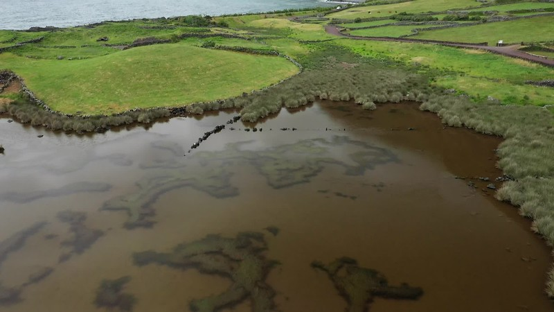 Available in 4K - Aerial video clip showing the lake of Fajã dos Cubres in a molly in move combined with tilt up, revealing the coastline.