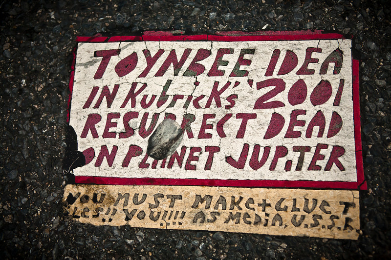Toynbee tile at a Delaware rest area on I-95. This tile is now gone.