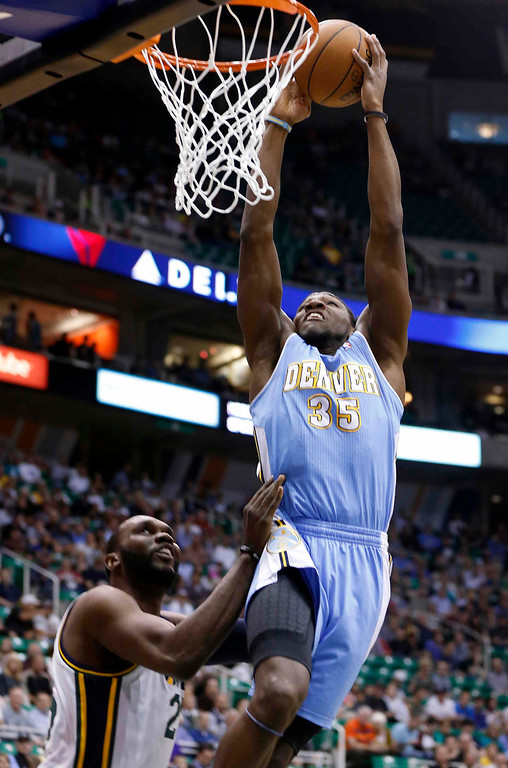 . Denver Nuggets forward Kenneth Faried (35) gets a dunk over Utah Jazz center Al Jefferson (25) during the first half of their NBA basketball game in Salt Lake City, Utah, April 3, 2013. REUTERS/Jim Urquhart