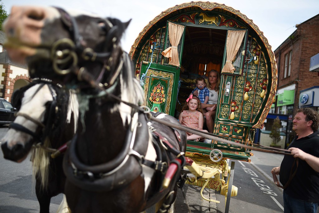 . A family travels in a traditional caravan or vardo on the opening day of the annual Appleby Horse Fair, in the town of Appleby-in-Westmorland, North West England on June 4, 2015. The annual event attracts thousands of travelers from across Britain to gather and buy and sell horses. AFP PHOTO / OLI SCARFF/AFP/Getty Images