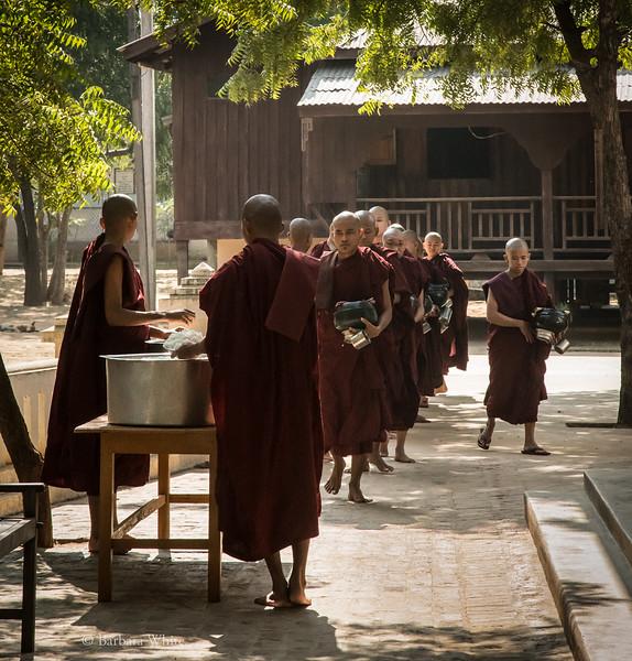 MonksInLineForRice.1.jpg