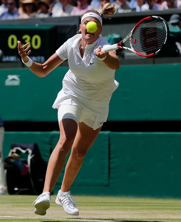 . Petra Kvitova of Czech Republic stretches to play a return to Lucie Safarova of Czech Republic during their womenís singles semifinal match at the All England Lawn Tennis Championships in Wimbledon, London, Thursday, July 3, 2014. (AP Photo/Ben Curtis)