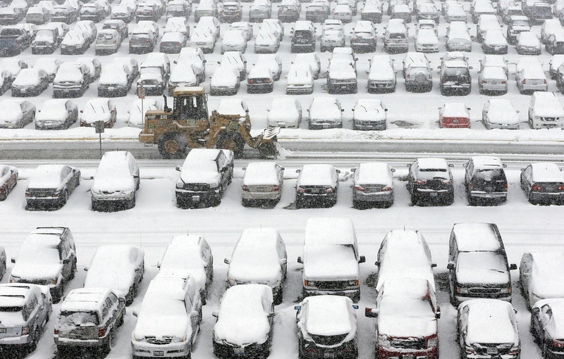 . A snow plow clears a parking lot at O\'Hare International Airport in Chicago on Tuesday, March 5, 2013. A late winter storm packing up to 10 inches of snow sent officials in weather-hardened Chicago into action Tuesday to prevent a repeat of scenes from two years ago, when hundreds of people in cars and buses were stranded on the city\'s marquee thoroughfare during a massive blizzard. (AP Photo/Nam Y. Huh)