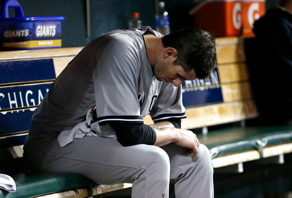 . New York Yankees pitcher Brandon McCarthy sits on the bench against the Detroit Tigers in the fifth inning of a baseball game in Detroit Tuesday, Aug. 26, 2014. (AP Photo/Paul Sancya)
