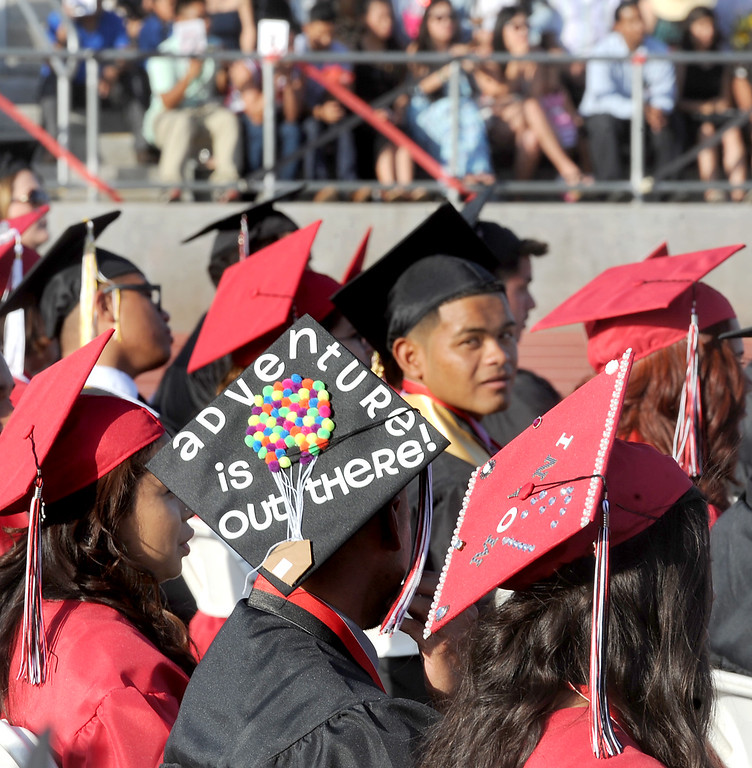 """. Ivan Ramos wearing a cap with the message \""""Adventure is Out there!\"""", during Sierra Vista High School Graduation in Baldwin Park Thursday, May 30, 2013.   (Walt Mancini/San Gabriel Valley News)"""