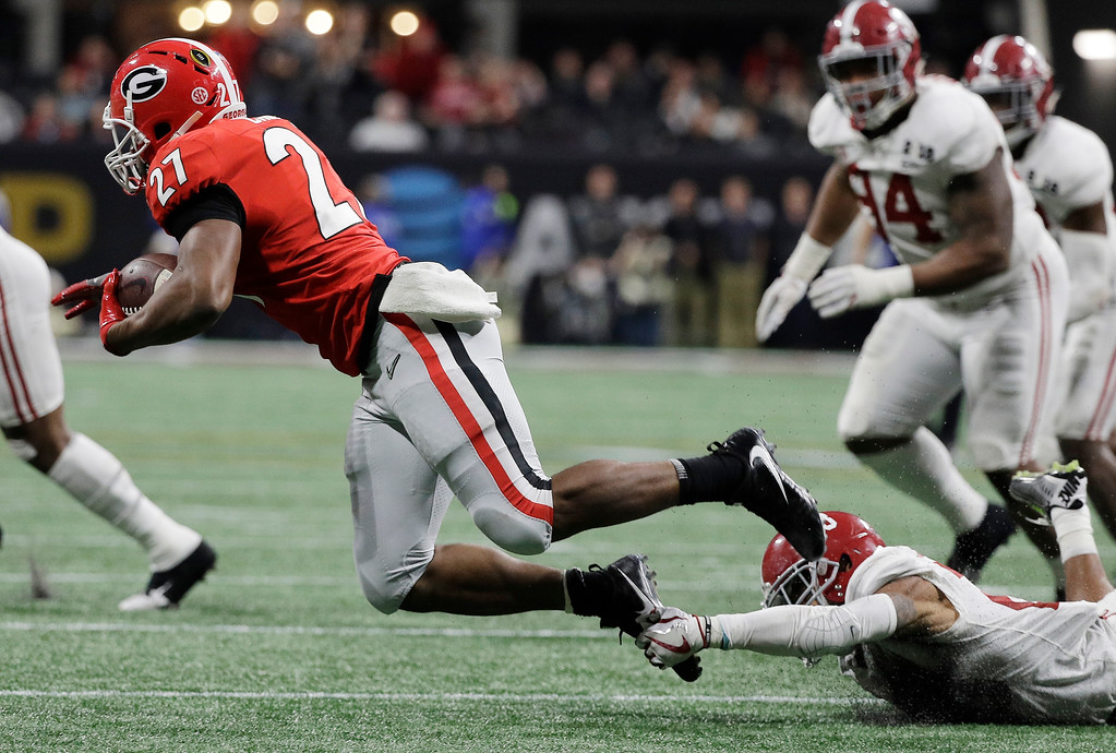 . Alabama\'s Anthony Averett trips up Georgia running back Nick Chubb for a loss during the second half of the NCAA college football playoff championship game Monday, Jan. 8, 2018, in Atlanta. (AP Photo/David J. Phillip)