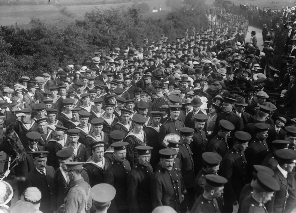 . May 1915:  A crowd of British sailors join the funeral procession in Eire for the victims of the sunken Lusitania.  (Photo by Topical Press Agency/Getty Images)