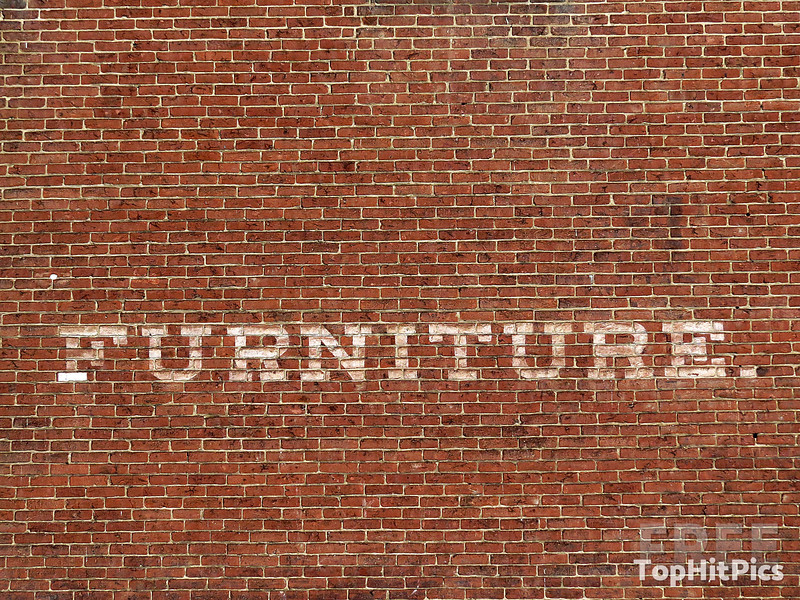 A Furniture Sign on a Brick Wall in Frenchtown, New Jersey
