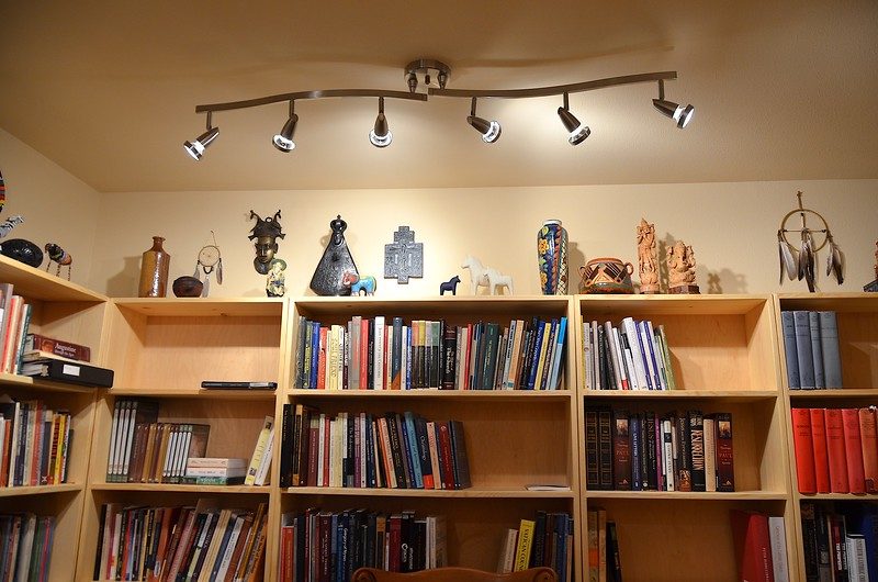 Artifacts from SCJ locations around the world are displayed above the library shelves