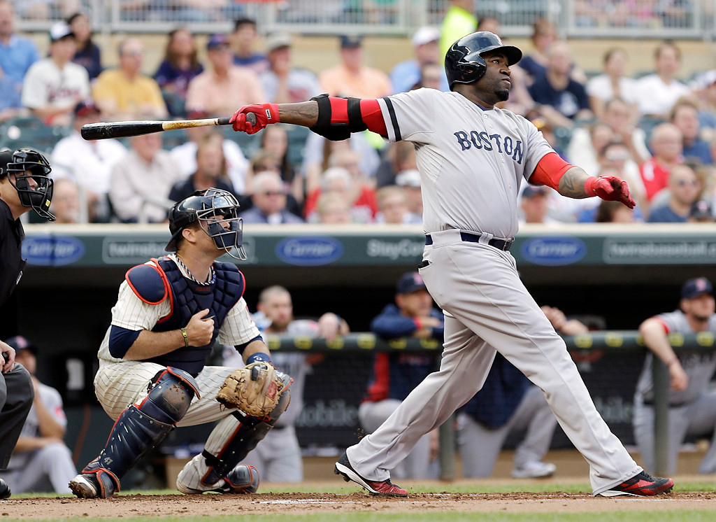 . Boston Red Sox\'s David Ortiz follows through on a three-run home run off Minnesota Twins starting pitcher Scott Diamond in the first inning of a baseball game, Saturday, May 18, 2013, in Minneapolis. At left is Twins catcher Ryan Doumit. (AP Photo/Jim Mone)