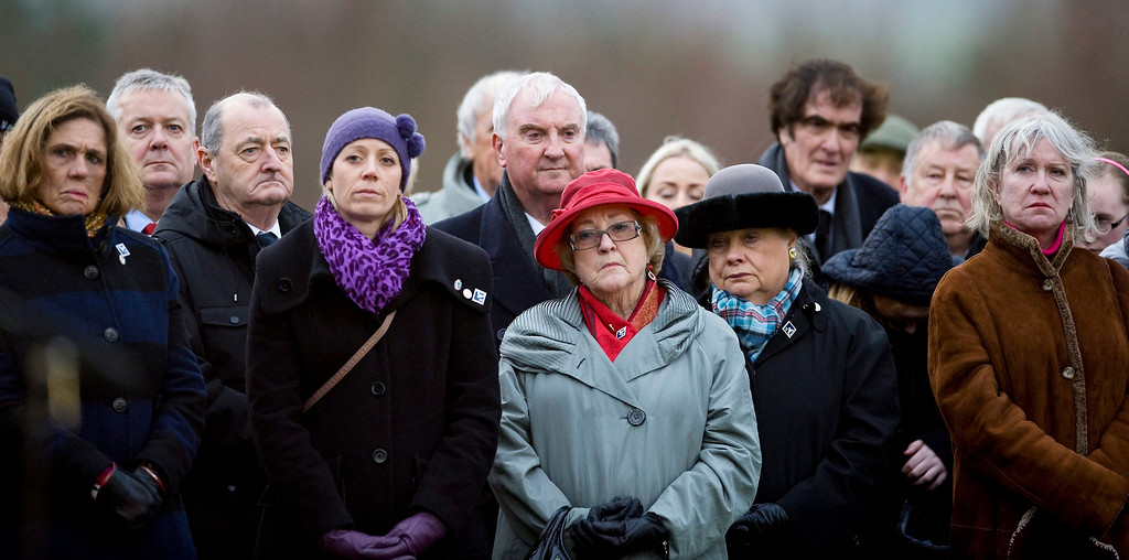 . Jane Schultz (2-R) who lost her son Tom and Sir John Orr (C, second row), a former Chief Constable who was the officer in charge the night Pan-Am 103 went down, attend a memorial ceremony at Dryfesdale Cemetery in Lockerbie, Scotland, 21 December 2013. Others are not identified.  EPA/BRIAN STEWART