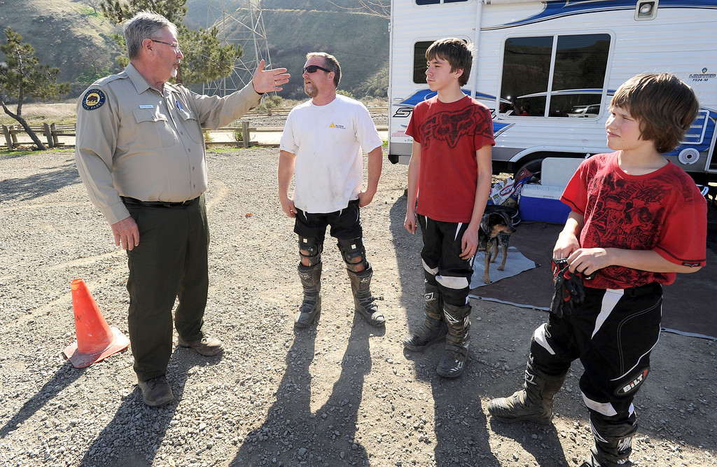 ". From left, Randy Caldera, acting sector superintendent for the Carnegie State Vehicular Recreation Area, talks to John Bauer, of Santa Rosa, John Bauer Jr., 15, and Justin Bauer, 12, at the Carnegie State Vehicular Recreation Area in Tracy, Calif., on Friday, Feb. 15, 2013. The California State Parks\' Off Highway Vehicle division has plans to use the nearby coal mining town of Tesla and the 3,500-acre area to expand the Carnegie State Vehicular Recreation Area. However, a group called ""Save Tesla Park\"" opposes the expansion. The group wants the land designated as a low-impact recreation park, and historic and natural resource preserve. (Doug Duran/Staff)"