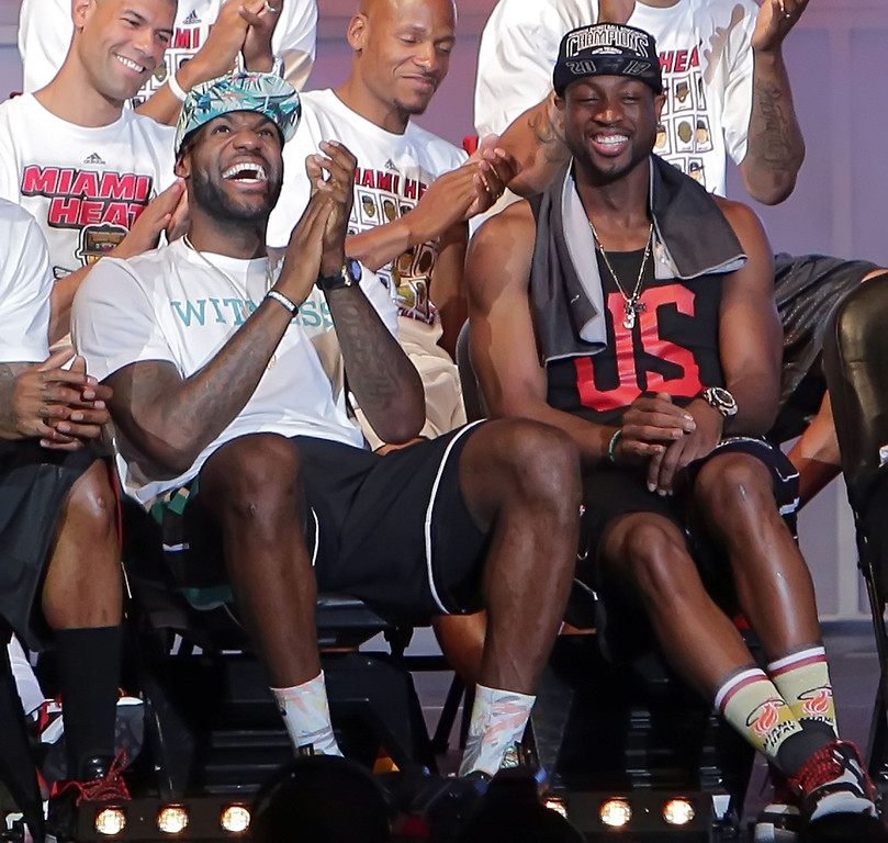 . LeBron James and Dwyane Wade of the Miami Heat attend their NBA Championship victory rally at the AmericanAirlines Arena on June 24, 2013 in Miami, Florida. The Miami Heat defeated the San Antonio Spurs in the NBA Finals.  (Photo by Alexander Tamargo/Getty Images)