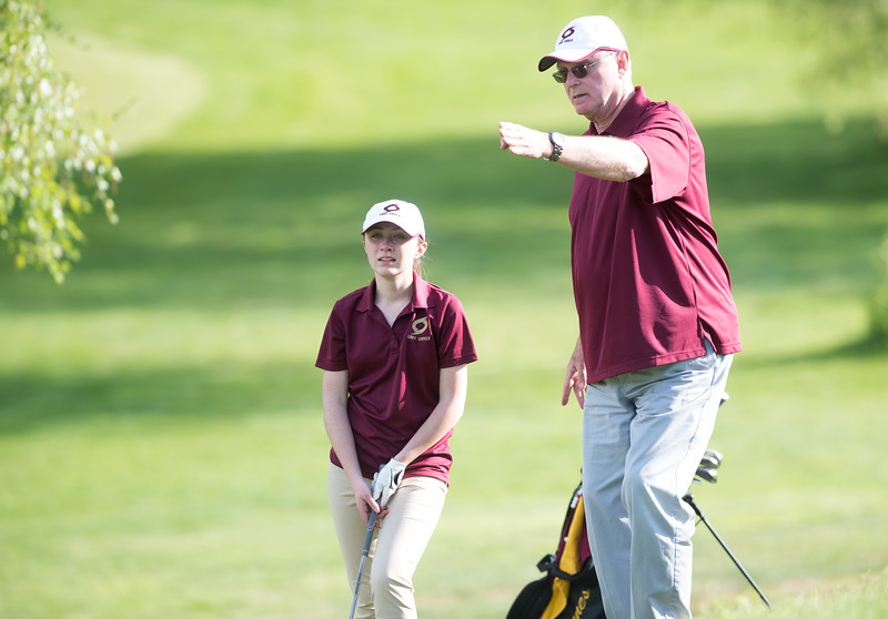 05/09/18  Wesley Bunnell | Staff  Berlin girls golf vs New Britain on Wednesday afternoon at Timberlin Golf Course in Berlin. New Britain's Katherine Keithline receives advice from coach Rich Carlson.