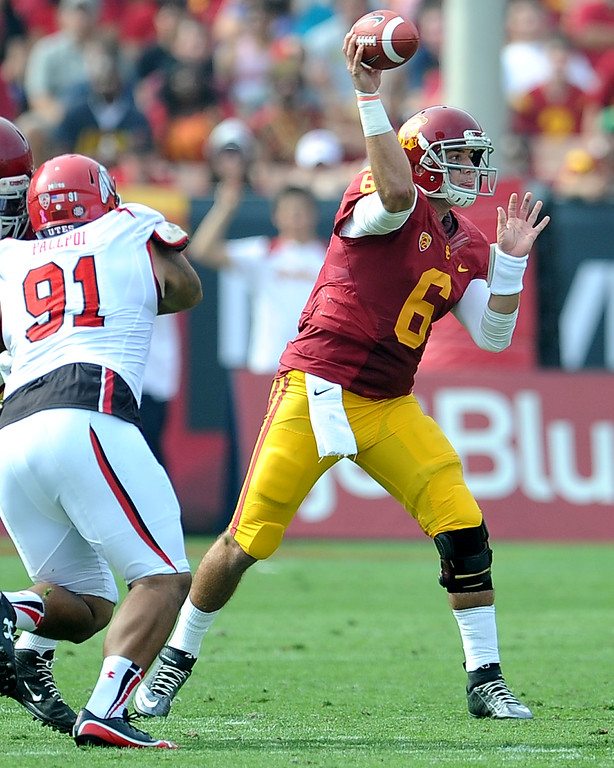 . Southern California quarterback Cody Kessler (6) passes in front of Utah defensive tackle Tenny Palepoi (91) during the first half of an NCAA college football game in the Los Angeles Memorial Coliseum in Los Angeles, on Saturday, Oct. 26, 2013.  (Photo by Keith Birmingham/Pasadena Star-News)