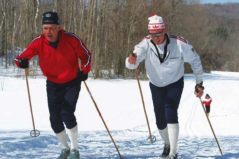 Bob Grey & Mike Gallagher Both are three time Olympians Distracting background skiers removed.