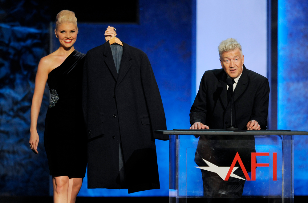 ". Director David Lynch, right, presents honoree Mel Brooks with a jacket that he wore during the filming of ""The Elephant Man,\"" during the American Film Institute\'s 41st Lifetime Achievement Award Gala honoring Brooks at the Dolby Theatre on Thursday, June 6, 2013 in Los Angeles. Brooks was the executive producer of \""The Elephant Man.\"" (Photo by Chris Pizello/Invision/AP)"