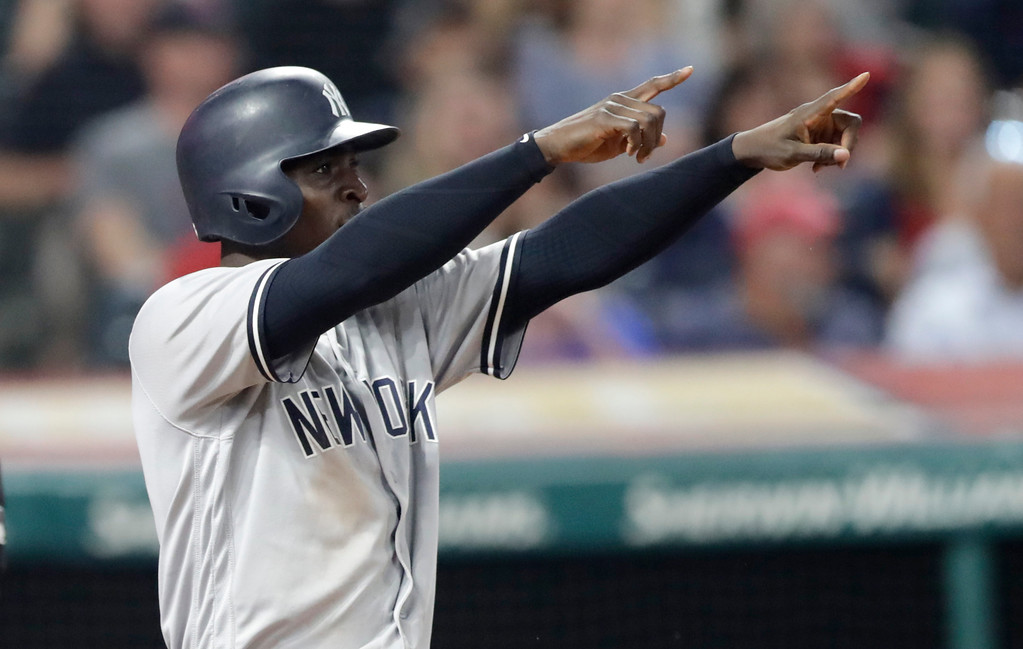 . New York Yankees\' Didi Gregorius looks toward Aaron Hicks at second base after Gregorius scored on a double by Hicks during the eighth inning of a baseball game against the Cleveland Indians, Thursday, July 12, 2018, in Cleveland. (AP Photo/Tony Dejak)